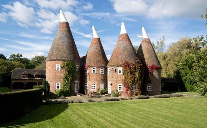 Converted oust house - An oast, oast house or hop kiln is a building designed for kilning (drying) hops as part of the brewing process. They can be found in most hop-growing (and former hop-growing) areas and are often good examples of vernacular architecture. Many redundant oasts have been converted into houses.