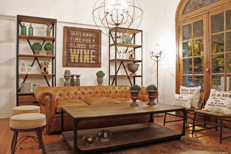 Living-room hierro y madera + chesterfield en cuero: Livings de estilo rústico por Estación Ortiz