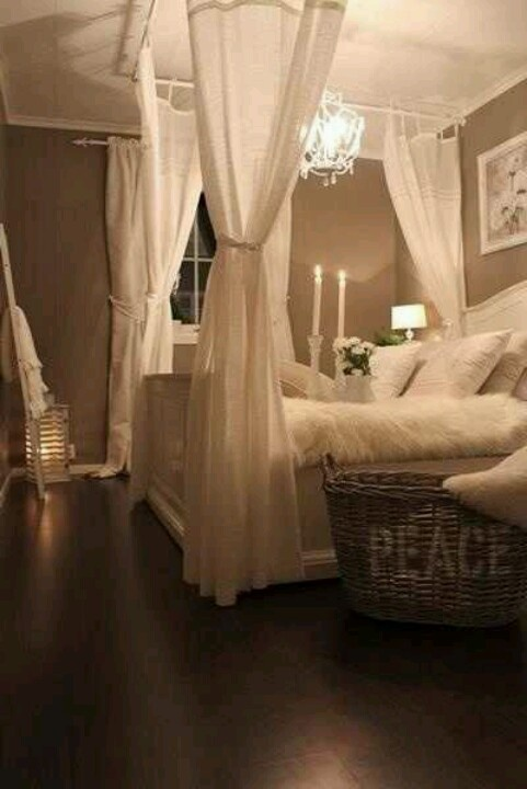 Neutral feminine peaceful bedroom with a canopy bed.
