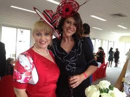 Milliner Tegan Crisafulli (left) with Odile Wilkins at the Townsville Cup