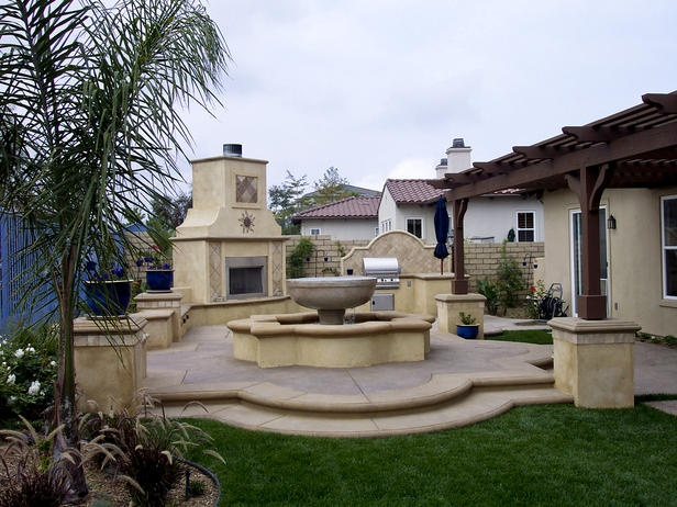SOUTHWESTERN BACKYARD PATIO AND FIREPLACE with fountain.