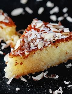 Basbousa - an easy Middle Eastern semolina cake drenched in cinnamon syrup and topped w/ coconut and shaved almonds!