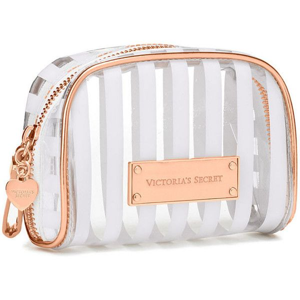 Victoria's Secret Mini Cosmetic Bag ($15) ❤ liked on Polyvore featuring beauty products, beauty accessories, bags & cases, pink, pink makeup bag, travel toiletry case, dopp bag, makeup purse and victoria's secret