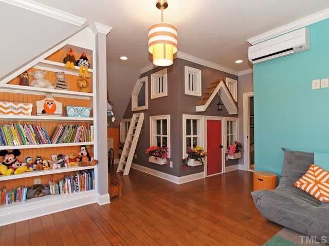 A-M-A-Z-I-N-G Second bonus room that is easily every child's dream space!  custom shelves, playhouse w/electricity and loft!