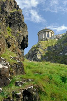 Mussenden Temple -- Located in Downhill Demesne near Castlerock, the Mussenden Temple is precipitously perched atop a 120-foot cliff edge overlooking the Atlant...