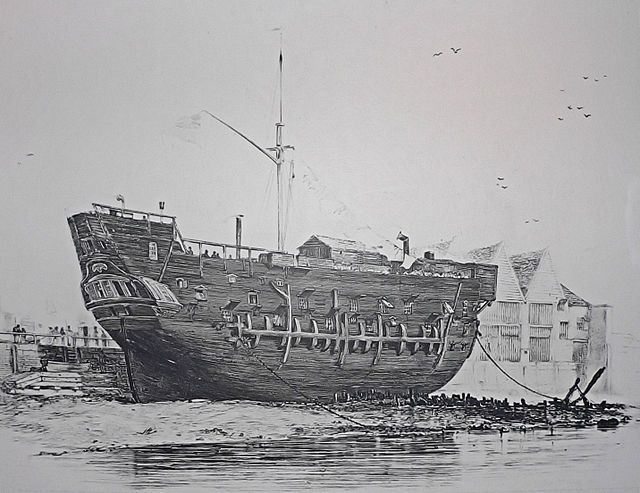 The forbidding form of the beached convict ship HMS Discovery at Deptford. Launched as a 10-gun sloop at Rotherhithe in 1789, the ship served as a convict hulk from 1818 until scrapped in February 1834.[3]