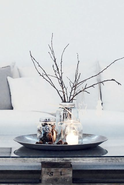 Decorate with natural items for Christmas | What you need: jars, twigs, white candle, pine cones, and a few simple white ornaments.