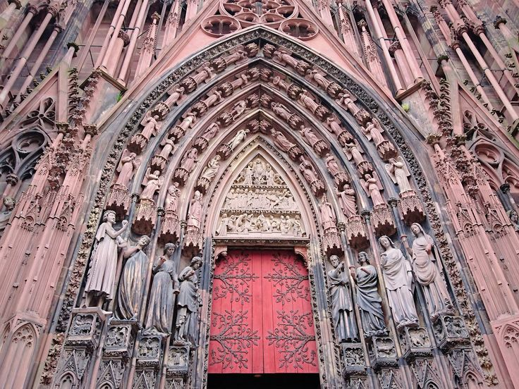 Ornated gothic door of Strasbourg cathedral, France.
