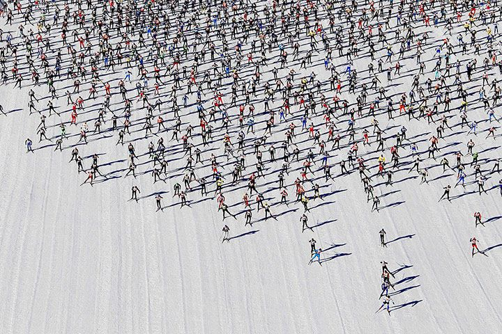Cross-country skiers start the Engadin Ski Marathon on the frozen Lake Sils at the village of Maloja near the Swiss resort of St. Moritz.