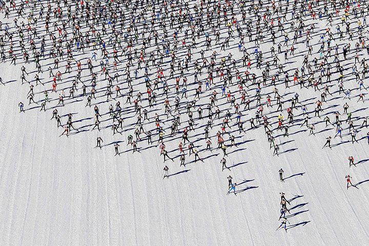 Cross-country skiers start the Engadin Ski Marathon on the frozen Lake Sils at the village of Maloja near the Swiss resort of St. Moritz.