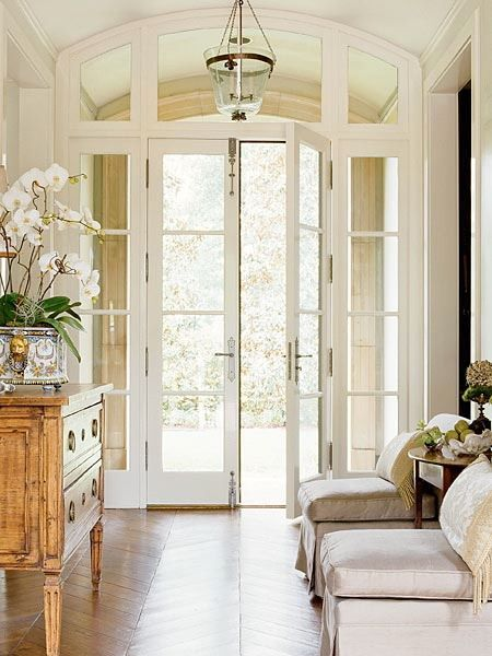 french doors + herringbone wood floors