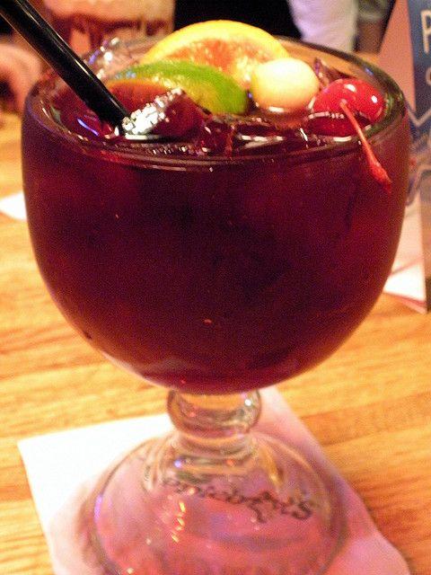 Red Apple Sangria  4 C. Sutter Home Cabernet Sauvignon  15 Oz. Shakka Apple Liqueur  6 Oz. Grenadine  18 Oz. Cranberry Juice(Ocean Spray)  18 Oz. Pineapple Juice  Lemon-Lime Soda    Garnish: Red apples-use mellonballer                Orange slices                Lime slices                Maraschino cherries    Add red wine, apple liqueur, grenadine and juices to a large pitcher. Top off each drink with soda.  Best served over ice.   Same recipe as Applebee's!!