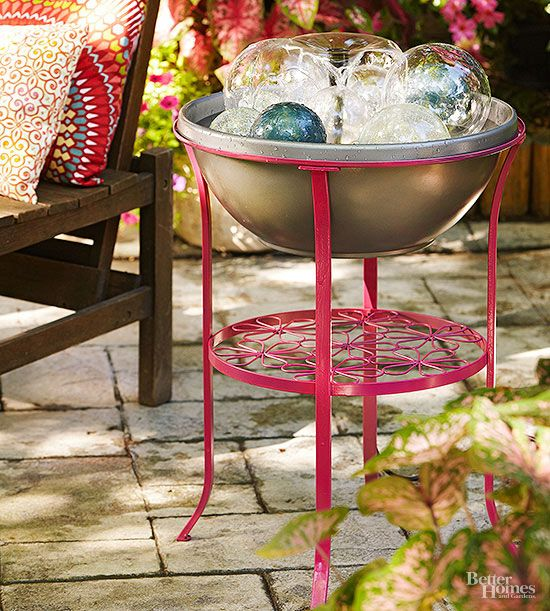 A small metal table (this one cost $40 at IKEA) becomes a fountain by swapping the glass top for a plastic planter bowl and dressing up both pieces with spray paint. A submersible pump and attached fountain bring the waterworks to life. Glass balls glisten under the water and conceal the pump. Tip: Replenish water as it evaporates, keeping the pump submerged to ensure it works properly. All pumps and fountains in these projects are available at home improvement centers.