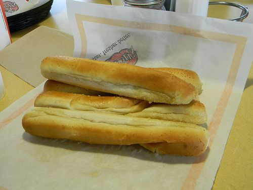 Fazolis Breadsticks Copycat Recipe My son works at Fazoli's. Buy the prepackaged bake and serve breadsticks that you find in the bakery section. Apparently Fazoli's doesn't make their own breadstick dough either. He told me that for their breadsticks they mix a product called Whirl with garlic and salt. Then, they spread it on pre-packaged breadsticks and bake. That's all I know. Hope it helps.