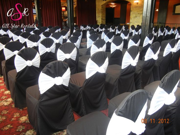 Black and white is always a great wedding concept!  Here we have the traditional black covers with a gorgeous white rosette tie.