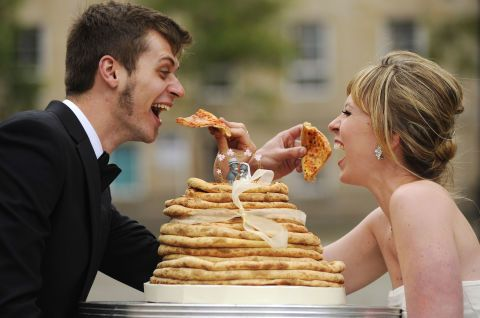 Pizza wedding cake. Pizza addicts, here's an idea for you. Simply stack up some pizza, stick a decoration on top and hey presto! The wedding cake alternative OF DREAMS.  (source) HOW TO HAVE A LOVELY WEDDING ON A *TIGHT* BUDGET