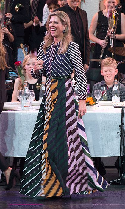 "<a href=""/tags/0/queen-maxima/"" target=""_blank"">Queen Máxima</a> of the Netherlands showed she's also the Queen of mixed prints in this Mary Katrantzou maxi dress at the Carré Theatre in Amsterdam.<br>Photo: © Getty Images"