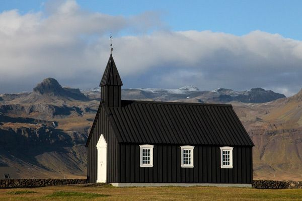 a black church in Iceland — so beautiful against the landscape