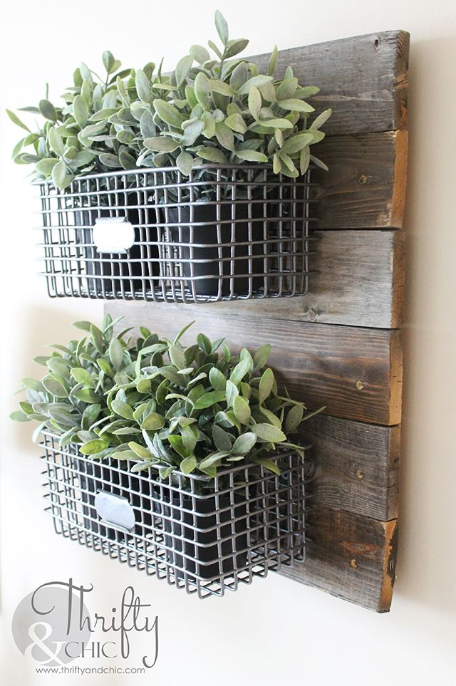 DIY Farmhouse Style Hanging Wire Baskets On Reclaimed Wood. Great way to infuse your house with fixer upper or farmhouse style!