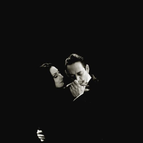Gomez: To live without you, only that would be torture.   Morticia: A day alone, only that would be death.