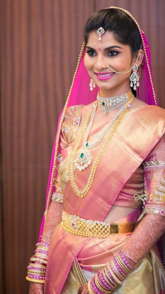 South Indian bride. Diamond Indian bridal jewelry. Jhumkis.Pink kanchipuram sari.Braid with fresh jasmine flowers. Tamil bride. Telugu bride. Kannada bride. Hindu bride. Malayalee bride.Kerala bride.South Indian wedding