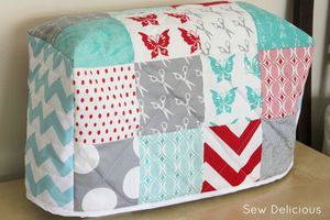 Quilted sewing machine cover from Sew Delicious. Great idea to use charm pack for this.