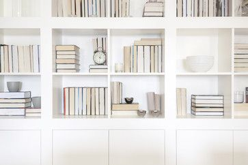 hide the spines and show only the neutral pages in white, ivory and beige. #bookshelves