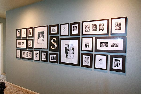 love the modern layout.  great balance of sizes and shapes picture frame wall family