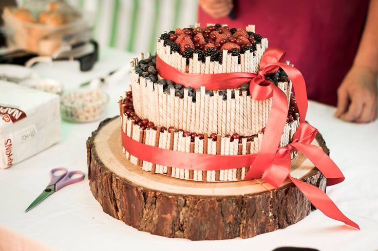Wedding cake with chocolate stick and fruit