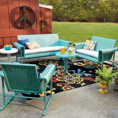 I'd love this retro glider or sofa, plus a chair and table in the front, too. I'd choose white, with  light blue or multi-striped cushions. Just a little vignette to increase curb appeal--and give me another place to hang out with a book (and my buddy, Truman).