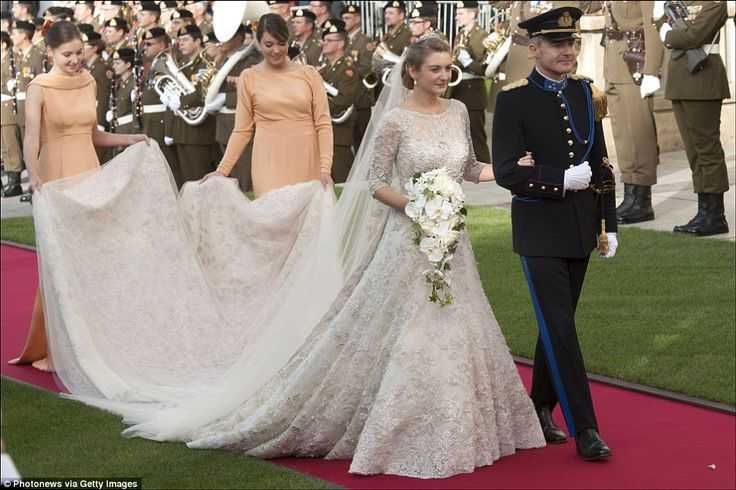 Spectacular: Countess Stephanie de Lannoy wore a magnificent Elie Saab creation for her October 2012 wedding to Prince Guillaume, Hereditary Grand Duke of Luxembourg. The dress took a 15 strong team an incredible 3,200 hours to create and was decorated with 50,000 pearls, 80,000 crystals and 10,000 metres of silver embroidery thread. She topped off the look with the pearl and diamond Lannoy tiara