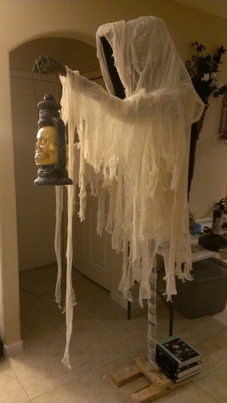 My ghost I made for last year's Halloween party...I miscalculated how heavy it was going to be, but nothing some old college books can't handle! :)