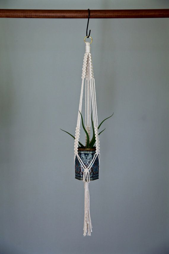 This small macrame plant hanger is handmade with 3mm natural white cotton rope and hung by a small brass ring. Hang a few together to showcase a variety of pots and plants! Makes a lovely gift!  Measures approx. 25 long. Hanging length will vary depending on the size and shape of pot used. Shown with a pot that is 3 in diameter and 4 tall. Best if used indoors with a nonporous pot.  This item is MADE TO ORDER! Please allow 1-3 business days for production.  ✦ Shop Plant Hangers ✦…