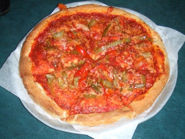 ok...for all my peeps who aren't from OHIO...this is a briar hill pizza...named after the area it originated from in Y-town...no mozz cheese, sauce, roasted green peppers, little parm...yummer