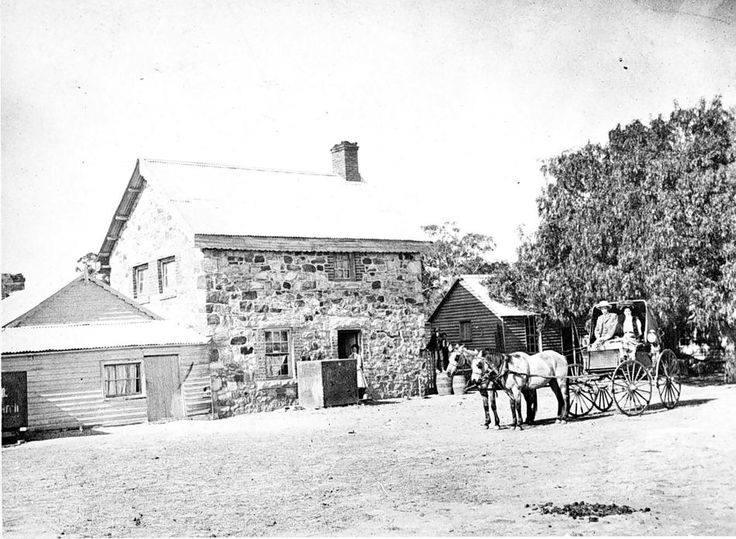 Walmer Homestead with owner John Duncan MacInnes' family, Horsham District, circa 1900. The 2-storey stone building is the kitchen, with servant's quarters above. The family lived  in the large timber homestead of 15 rooms, separated from kitchen block. Walmer Estate had previously been owned by the Carter  family before it was acquired during closer settlement and the land divided.
