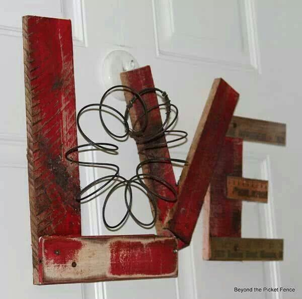 LOVE made from the lumber and recycle wire FB beyond the picket fence...