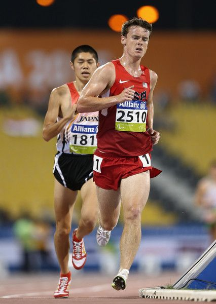 Michael Brannigan Photos Photos - Michael Brannigan of the United States competes in the men's 5000m T20 final during the Evening Session on Day Nine of the IPC Athletics World Championships at Suhaim Bin Hamad Stadium on October 30, 2015 in Doha, Qatar. - IPC Athletics World Championships - Day Nine -  Evening Session