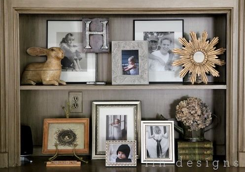 bookshelf styling...hmmm maybe need more rectangular frames to add interest/height in the back