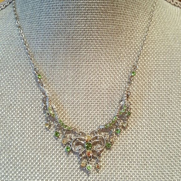 Genuine Austrian Crystal necklace set Butterfly crystal green and yellow gems. Exquisite detail in the design of this necklace.  Never been worn.  Excellent condition.  Bundle for discount. Comes with matching earrings. Noblesse Collection  Jewelry Necklaces
