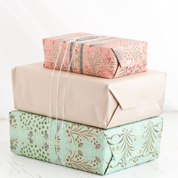 Lovely pastel papers and white yarn makes for gifts that are pretty as a picture (ha!)!