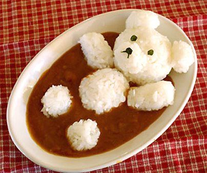Cutest curry rice ever! Seems like just  lots of onigiri very carefully positioned, plus some nori for the face. Might not be hard to do. (Famous last words!)