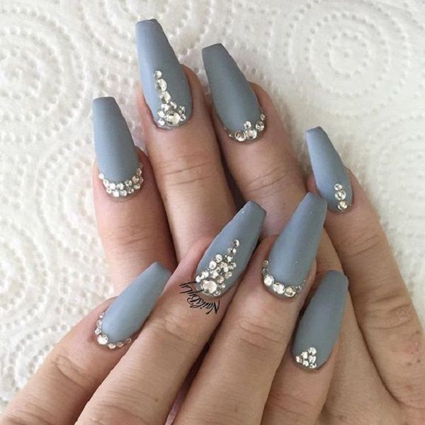 Matte Grey Nails with Diamonds. This matte and studded look is perfect for your casual denim look.