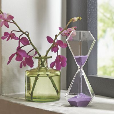 Hourglass Sand Timer from Midnight Velvet.  A little bit glam, a little bit whimsical, this hour glass has diamond shaped receptacles on either end and purple sand inside.