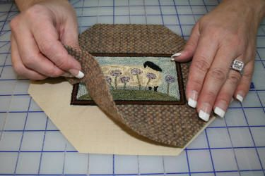 Threads That Bind  How to frame a punchneedle piece in wool