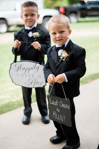"""Adorable ring bearer idea - ring bearers in matching black tuxes with black bow ties + peach boutonnieres carrying signs that read """"happily ever after"""" + """"last chance to run"""" {Rockhill Studio}"""