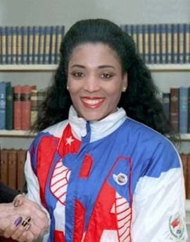 Florence Delorez Griffith Joyner, also known as Flo-Jo, was an American track & field athlete. She is considered the fastest woman of all time based on the fact that the world records she set in 1988 for both the 100 m & 200 m have yet to be seriously challenged. Griffith was born in Los Angeles, California, & was raised in the Jordan Downs public housing complex. This photo is from 1988.
