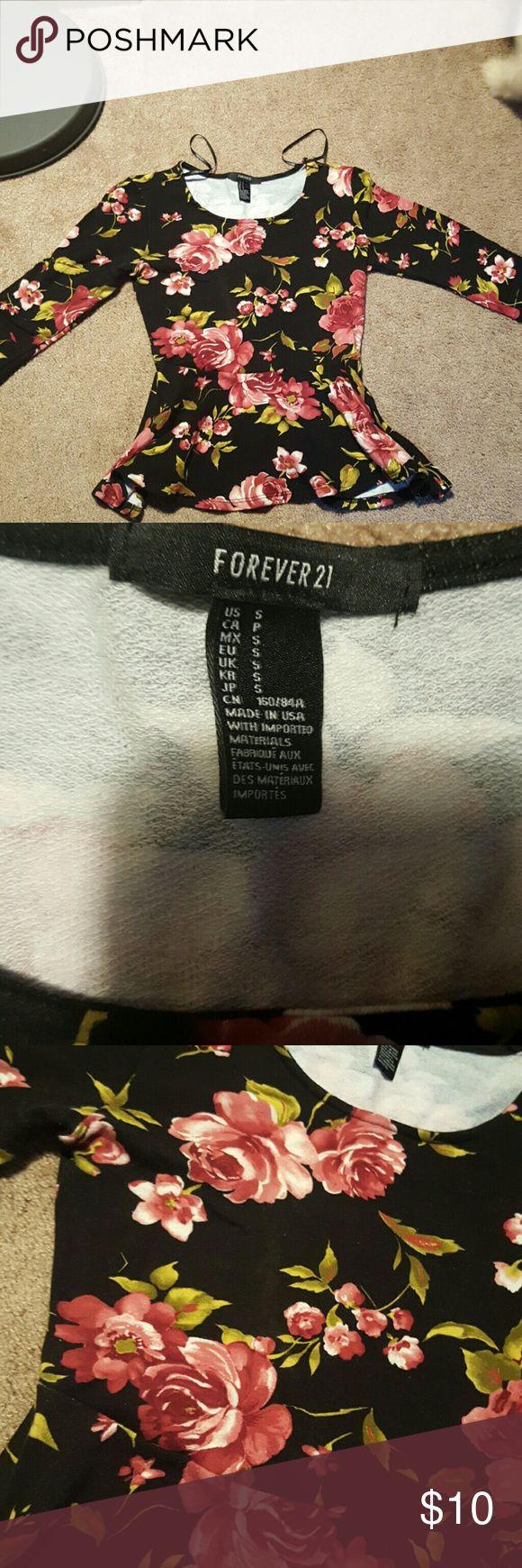 black and floral peplum top Super flattering black and floral peplum top. Forever 21 Tops Tees - Long Sleeve