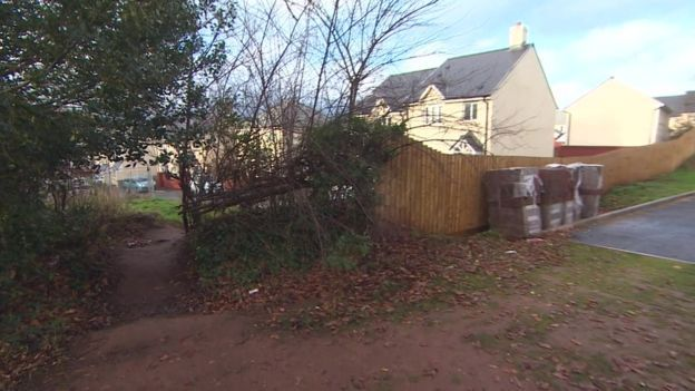 A housing estate has been split in two by a fence because of a 1ft height difference in a road between two halves of the development. The fence fiasco means a two-mile diversion for drivers to get down what should be one straight road in Dawlish. Developers on each side of the dividing line are adamant they followed plans.  Planning authority Teignbridge District Council and roads authority Devon County Council are getting together in the New Year to try and sort it out.
