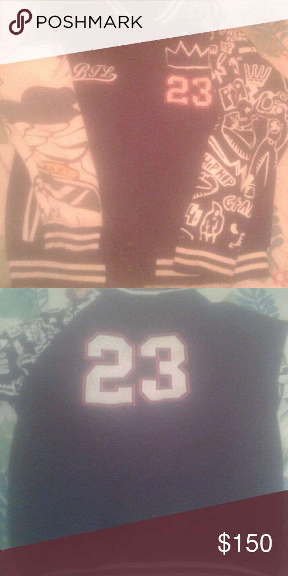 Jordan jacket Black, white, and red n lots of designs on sleeve Jordan Jackets & Coats