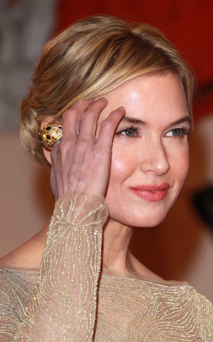 renee zellweger updo hair corall lips eyes ring hand love the renee zellweger updo hair corall lips eyes ring hand love the way they look her hair updo and eyes